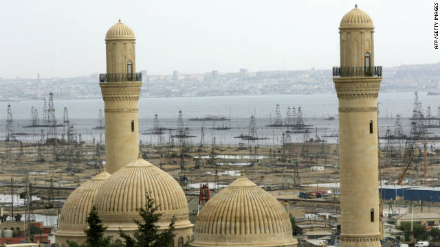 Oil derricks are glimpsed by a minarets of a<p>Article source: http://www.cnn.com/2011/11/10/world/europe/azerbaijan-country-profile/</p></div>  <p>Tags: <a href=