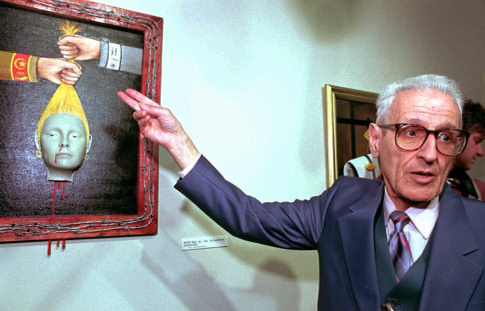 Dr. Jack Kevorkian with his painting, 'Genocide,' in 1997. Kevorkian pronounced a portrayal reflected a electrocute of Armenian Jews by a Ottoman Empire in World War we and a German army in World War II