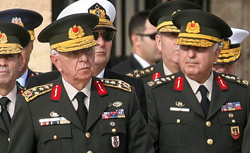 (Left) Gen. Isik Kosaner. Click picture to expand.